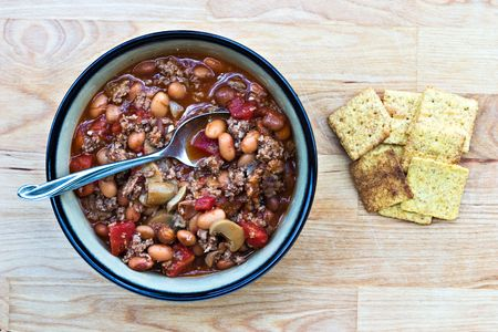 Bowl of turkey chili with crackers photo