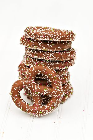 pretzel: A stack of chocolate covered pretzels on white beadboard. Stock Photo