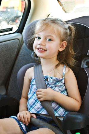 Child in a carseat photo