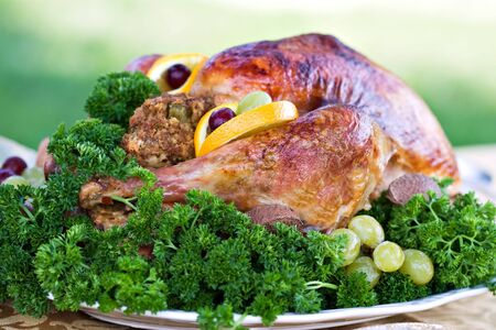 Roasted turkey on holiday table ready to eat. photo