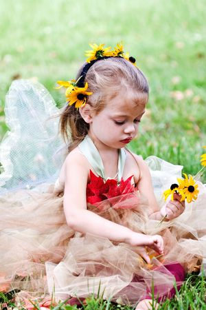 bare foot girl: A little woodland fairy gathering flowers. Stock Photo