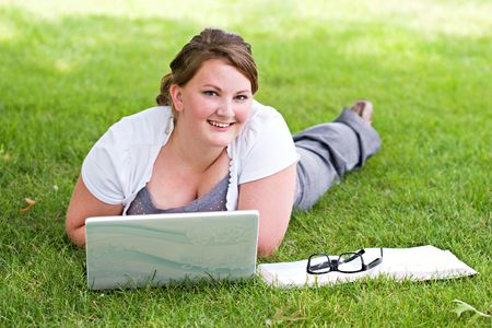 Young college student studying on the campus grounds.  photo