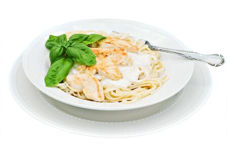 fettuccine: Chicken alfredo with basil isolated on white