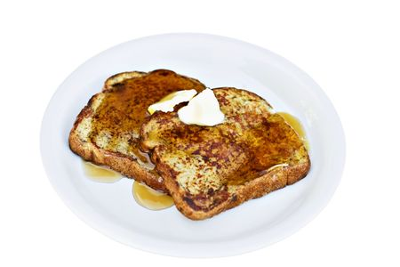 French toast made from raisin bread with syrup and butter.  Banco de Imagens