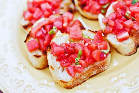 Fresh bruschetta with tomato and basil. Shallow DOF.  Stock Photo - 5508371