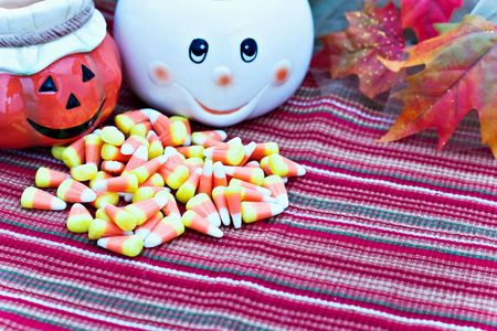 cute ghost: Cute ghost and jack o lantern with Halloween candy.