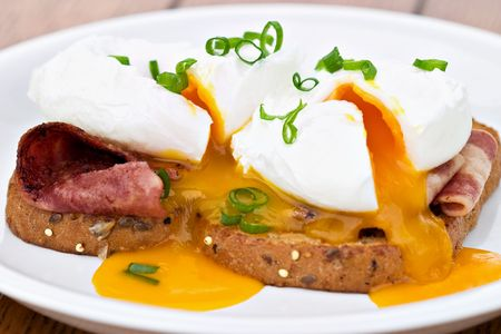 turkey bacon: Sliced poached eggs over turkey bacon and whole wheat toast. These are fresh free range eggs, so the yolk is a nice rich color.