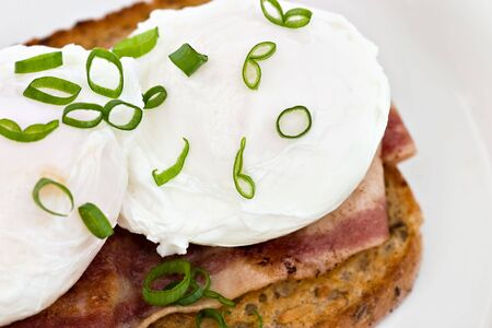 turkey bacon: Poached eggs garnished with chives over turkey bacon and whole wheat toast.