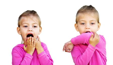 elbow: Little girl demonstrates the incorrect and correct way to cough to avoid spreading unwanted germs.