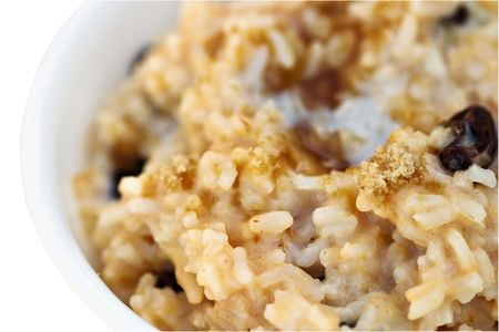 raisin: Macro of delicious sweet pumpkin custard rice with brown sugar sprinkled on top.
