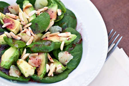 'baby spinach': Avacado Salad with baby spinach and a raspberry vingerette.