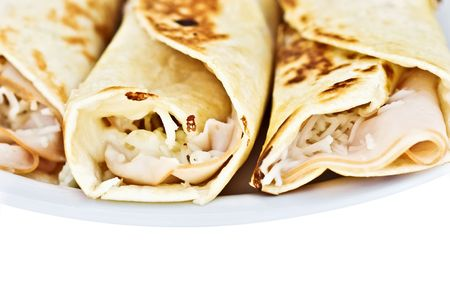 browned: Turkey and cheese wrapped in tortillas and fried till golden.  Stock Photo