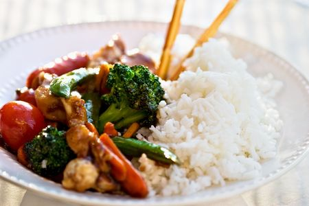 Stir Fried vegetables and chicken with rice. Selective focus on the center.  photo