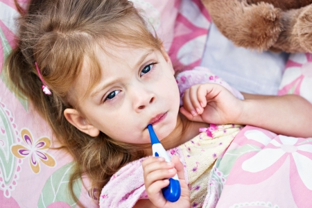 Little girl is not feeling well and is having her temperature taken. Stock Photo - 5688562