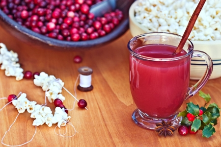 bowls of popcorn: Delicious mixed cranberry drink with spices. Stock Photo
