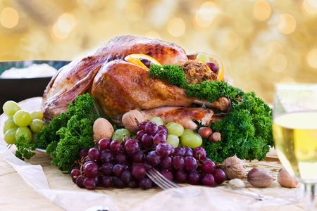 holiday turkey: Roasted turkey on holiday table ready to eat. Selective focus on turkey. Stock Photo