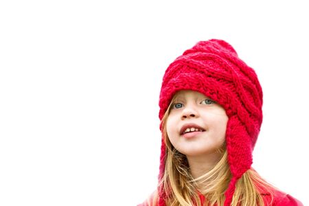 Happy little girl dressed for winter with copy space. photo