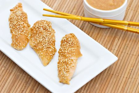 tenders: Pineapple Chicken Tenders with chop sticks and dipping sauce.   Stock Photo