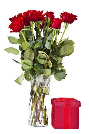 Dozen red roses and a gift box isolated on a white background.