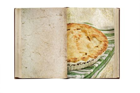 Old book with clipping path. Photo based illustration of an apple pie with a golden buttery crust and room for text on blank page.  illustration
