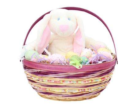 Easter basket with beautifully decorated eggs and adorable bunny.    photo
