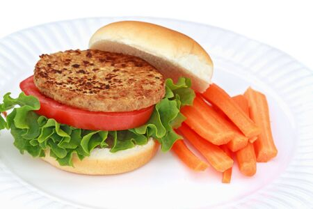 Delicious soy based vegan burger with fresh vegetables.