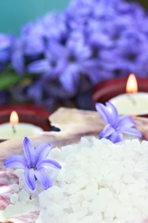 Relaxing and beautiful spa still life with candles, purple flowers and bath salts.  Stok Fotoğraf