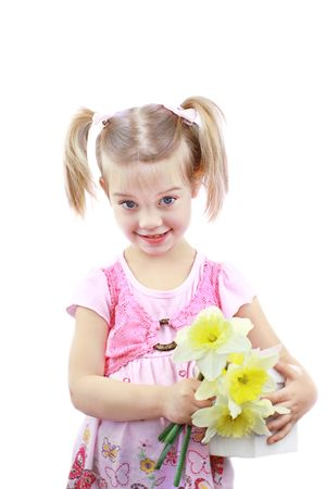 puckered: Adorable little girl  holds fresh picked flowers and a giftbox for Mom on Mothers Day. Stock Photo