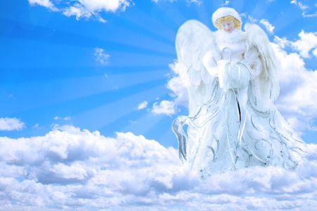 cherubs: Beautiful generic angel praying in the sky with rays of light coming from behind her. Stock Photo