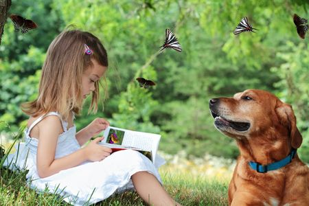 Little girl sits under a tree reading a book about butterflies as her faithful dog sits nearby watching butterflies fly around them. Butterfly, including one in book, are my own photos.