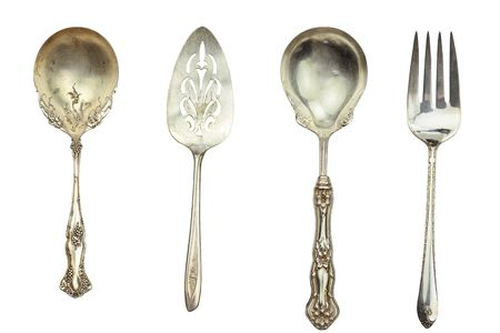tarnish: Antique silverware isolated on white. Stock Photo