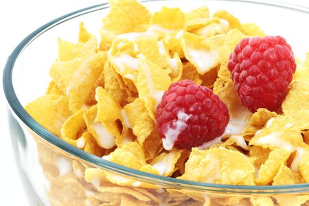Cereal with milk and fresh raspberries in a clear bowl isolated on white. Stock Photo - 7235173
