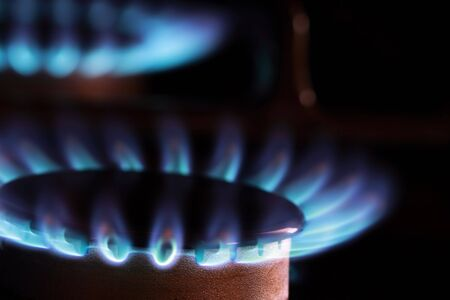 Close up of blue flames from gas kitchen range. Stock Photo