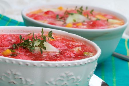 Watermelon Gazpacho made with watermelon, yellow peppers, cucumber, and garnished with a sprig of fresh thyme. photo