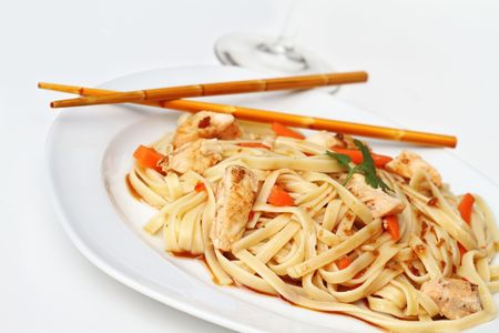 Plate of delicious healthy Asian Chicken Pasta with grilled chicken and carrots. Extreme shallow DOF with selective focus on front on noodles. Stock Photo - 7553481