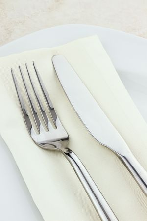 Place setting silverware and napkin.  photo