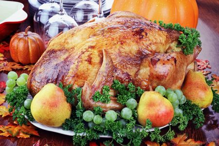 Thanksgiving turkey with fresh pears and grapes. Stock Photo
