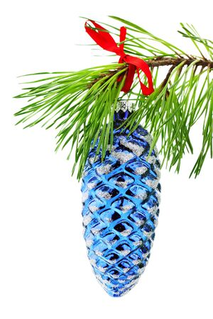 Christmas ornament hanging from branch isolated on a white background.  photo