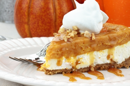 crust: Slice of Double Layer No Bake Pumpkin Pie made with pumpkin, vanilla pudding,cream cheese, and whipped cream.