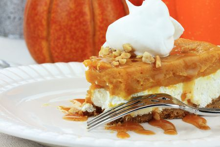 Slice of Double Layer No Bake Pumpkin Pie made with pumpkin, vanilla pudding,cream cheese, and whipped cream.  photo