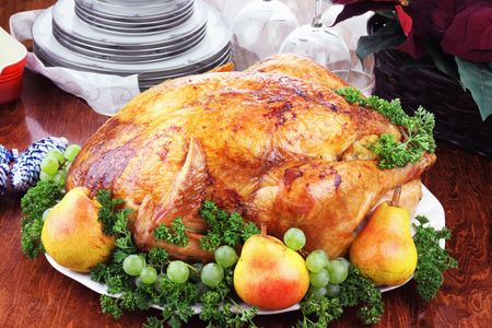 Christmas turkey dinner with fresh pears, grapes and parsley. photo
