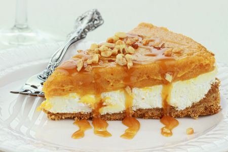 Slice of Double Layer No Bake Pumpkin Pie made with pumpkin, vanilla pudding,and cream cheese ready for Thanksgiving or Christmas dinner. Stock Photo - 8219089