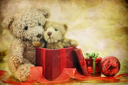 An old antique teddy hugs his new little teddy bear friend in this photo based illustration. Copyspace available. Stock Photo