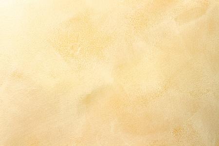 Macro van stuc werk muur met zachte warme tinten.