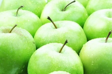 Freshly washed green apples ready to be eaten.