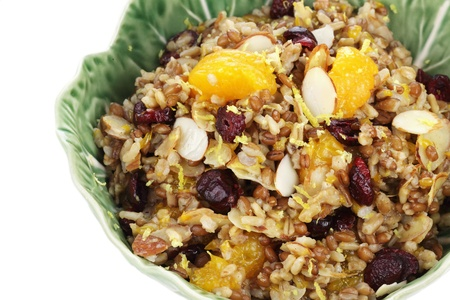 Pilaf with whole grains, nuts, and dried fruit for a delicious side dish or breakfast. Clipping path included. photo