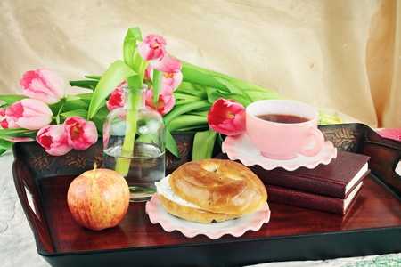 Breakfast tray with hot coffee, flowers and food. Shallow DOF.