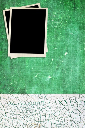 Grungy green background with blank photos.  Stock Photo
