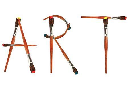 leveringen: Geïsoleerde verfborstels vormen het woord kunst tegen een witte achtergrond. Stockfoto