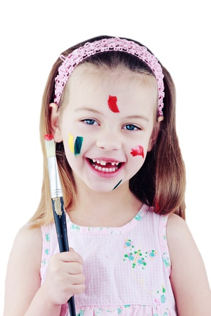 Child with paint brush covered in paint and isolated on white.
